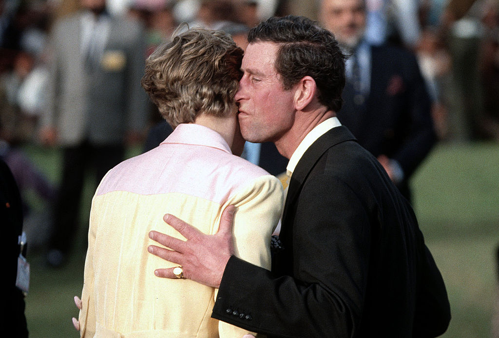 Princess Diana and Prince Charles kiss during a prize giving ceremony at a polo match in Jaipur during a visit to India