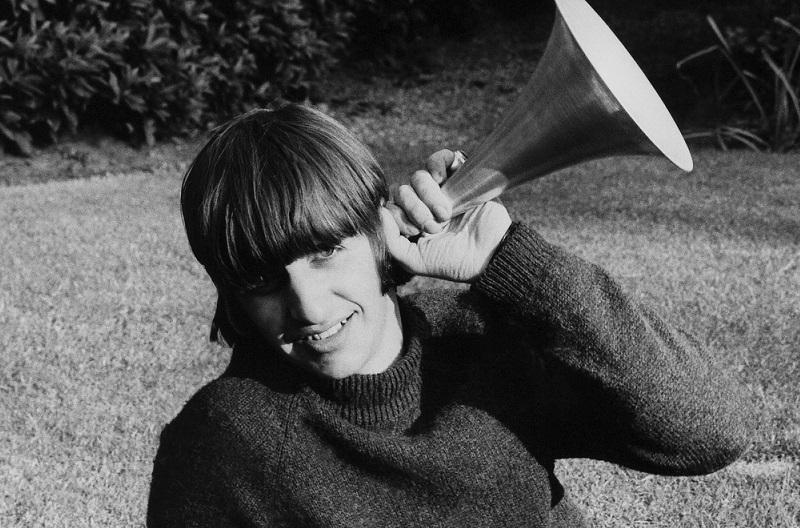 Ringo Starr poses in a garden, circa 1964