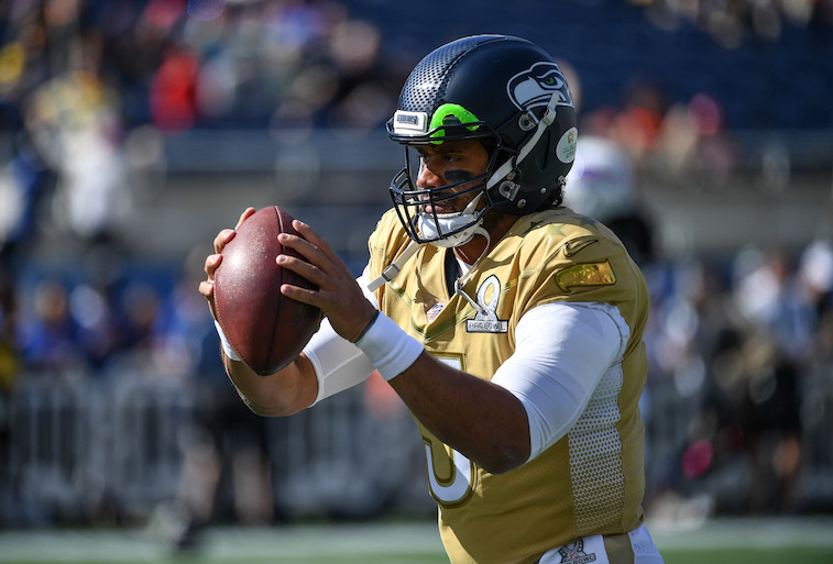 Russel Wilson playing football
