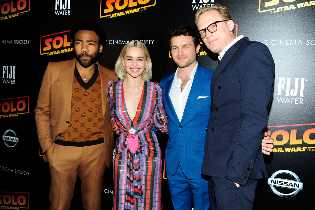 Donald Glover, Emilia Clarke, Alden Ehrenreich, and Paul Bettany pose at a screening for 'Solo: A Star Wars Story'