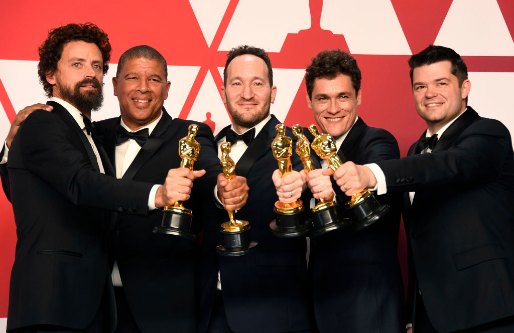 """(L-R) Bob Persichetti, Peter Ramsey, Rodney Rothman, Phil Lord, and Christopher Miller, winners of Best Animated Feature Film for """"Spider-Man: Into the Spider-Verse,"""" pose in the press room during the 91st Annual Academy Awards at Hollywood and Highland on February 24, 2019 in Hollywood, California."""