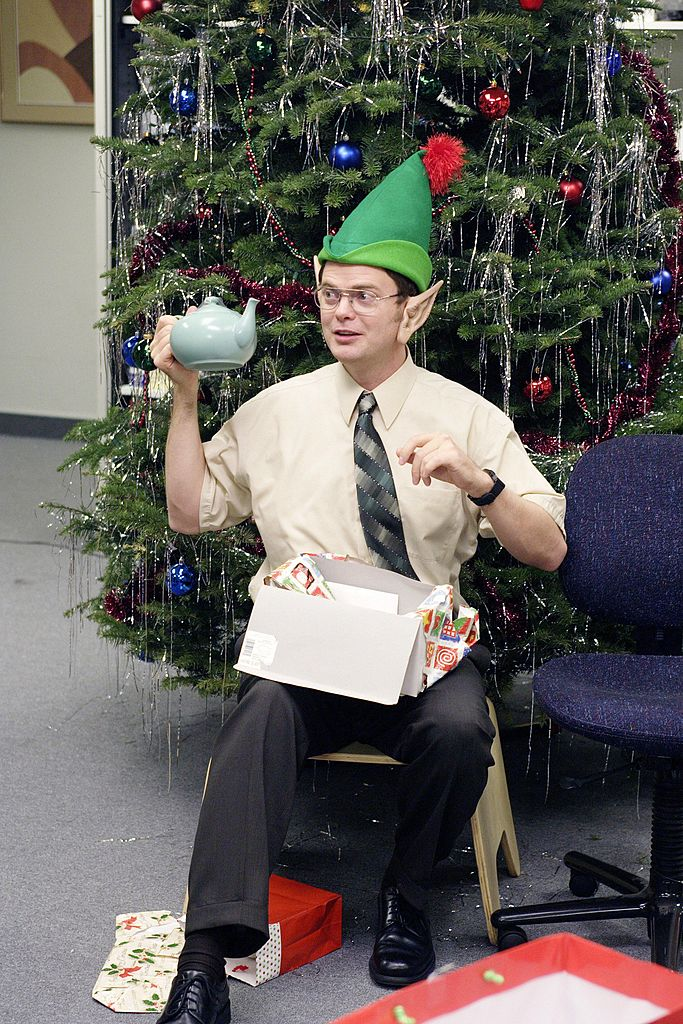'The Office' scene from 'The Christmas Party' Rainn Wilson as Dwight Schrute holding a teapot