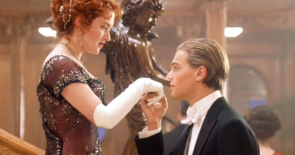 Kate Winslet and Leonardo DiCaprio in Titanic near the film's staircase