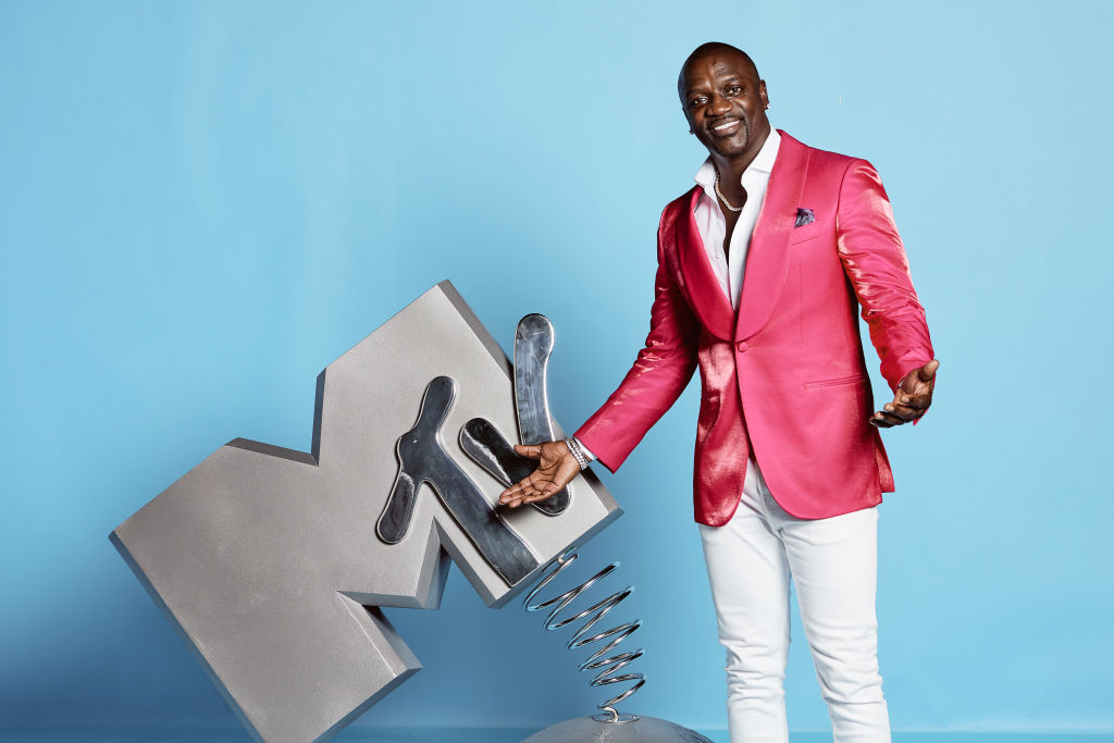 Akon poses at the MTV EMAs 2019 studio at FIBES Conference and Exhibition Centre