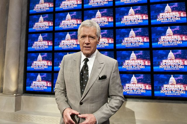 Alex Trebek stands in front of monitors at a rehearsal for taping of 'Jeopardy!' Power Players Week