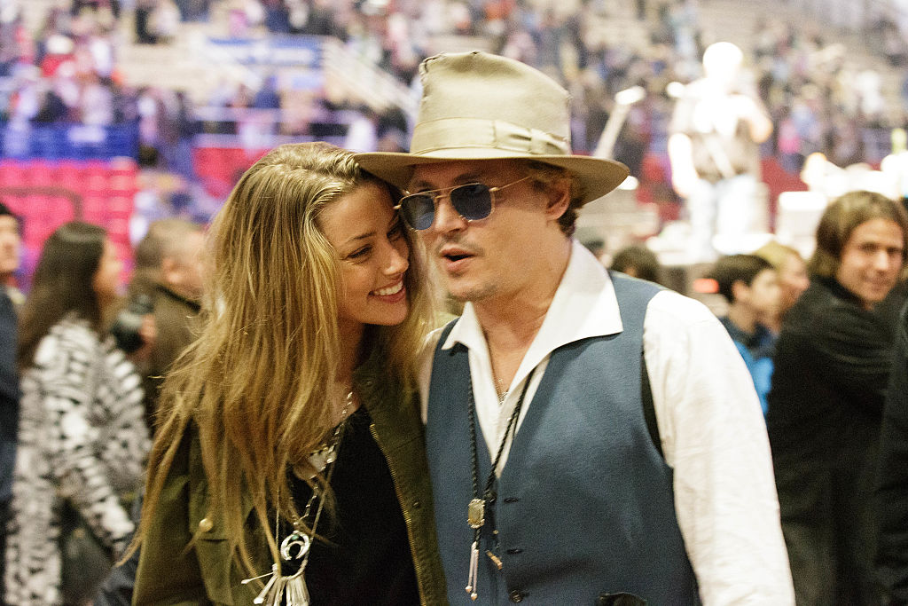 Johnny Depp and Amber Heard at Rodeo Austin at the Travis County Expo Center on March 9, 2014