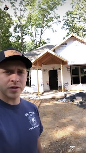 Austin Forsyth stands outside the couple's newest home project.