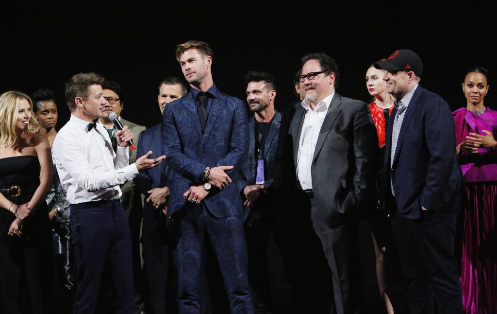 (L-R) Scarlett Johansson, Jeremy Renner, Chris Hemsworth, Executive producer Jon Favreau, and President of Marvel Studios/Producer Kevin Feige speak onstage