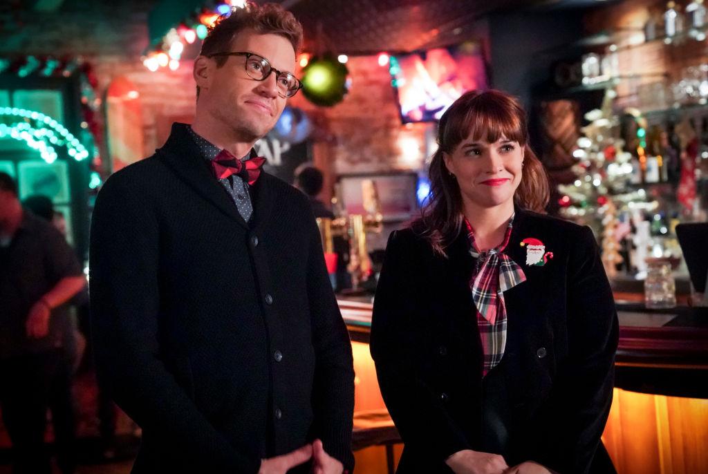 Barrett Foa (Tech Operator Eric Beale) and Renée Felice Smith (Intelligence Analyst Nell Jones on the set of NCIS LA