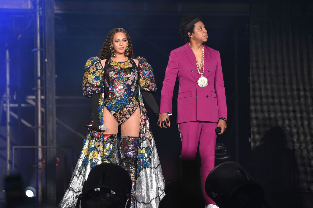 Beyoncé and Jay-Z smiling on stage, holding hands