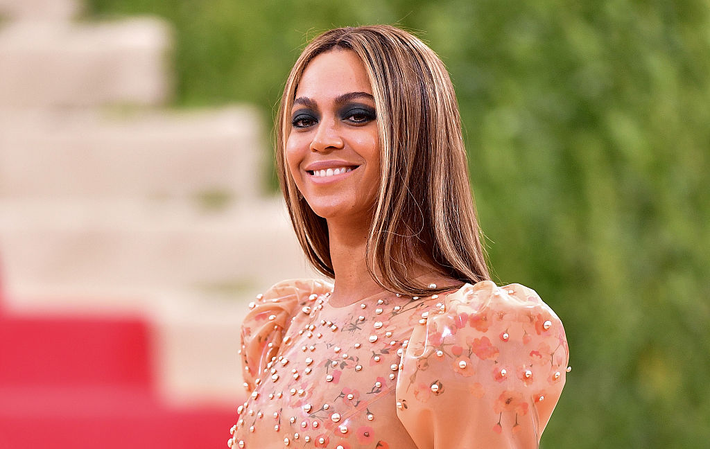Beyoncé smiling looking off to the side