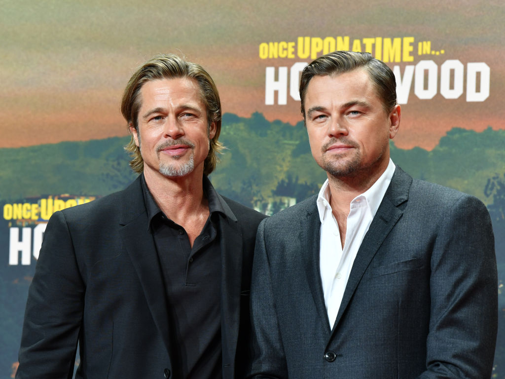 Brad Pitt (l) and Leonardo DiCaprio come to the premiere of their movie 'Once upon a time...in Hollywood'