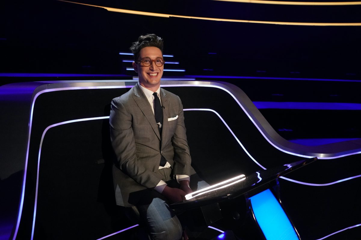 Buzzy Cohen smiles on the set of 'Who Wants To Be A Millionaire?' in 2020