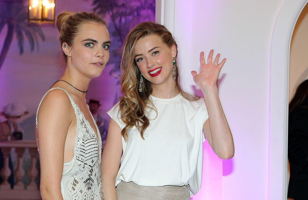 Amber Heard, Cara Delevingne (L) attend the Porsche At De Grisogono 'Fatale In Cannes' Party