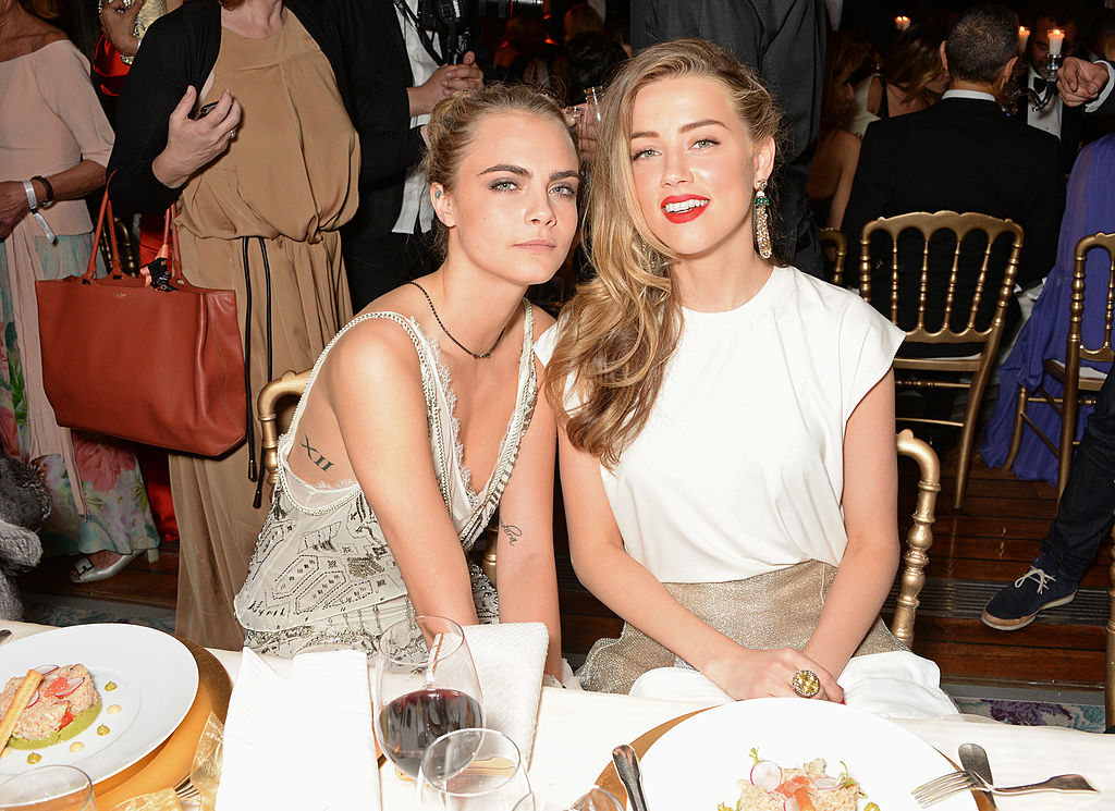 Cara Delevingne (L) and Amber Heard attend the de Grisogono 'Fatale In Cannes' party