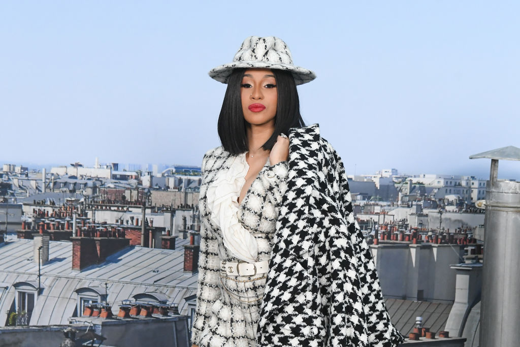 Cardi B smiling wearing a black and white outfit