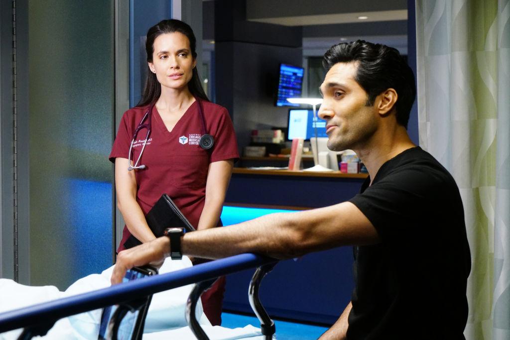 Torrey DeVitto as Natalie Manning, Dominic Rains as Crockett Marcel working over a gurney on 'Chicago Med'