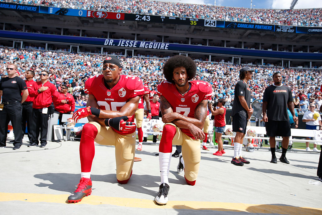 Eric Reid and Colin Kaepernick kneeling together in a stadium
