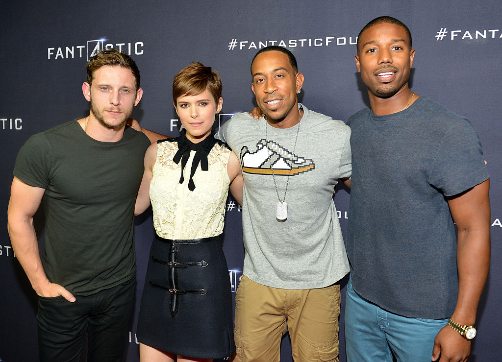 Jamie Bell, Kate Mara, Ludacris and Michael B. Jordan smiling in front of a 'Fantastic Four' background