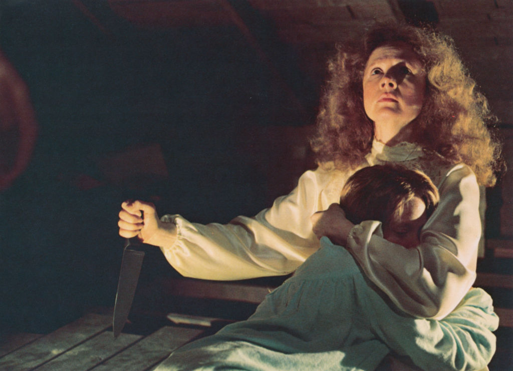 Piper Laurie (with knife) and Sissy Spacek star in the film 'Carrie'