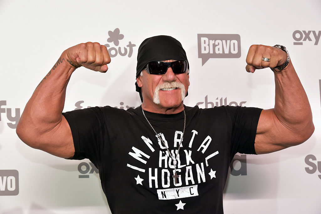 Hulk Hogan flexing  at a red carpet event