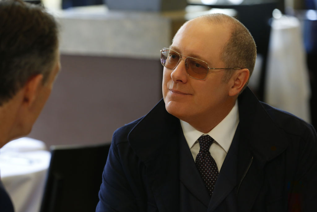 """James Spader as 'Ray"""" in a scene with another actor on The Blackist."""