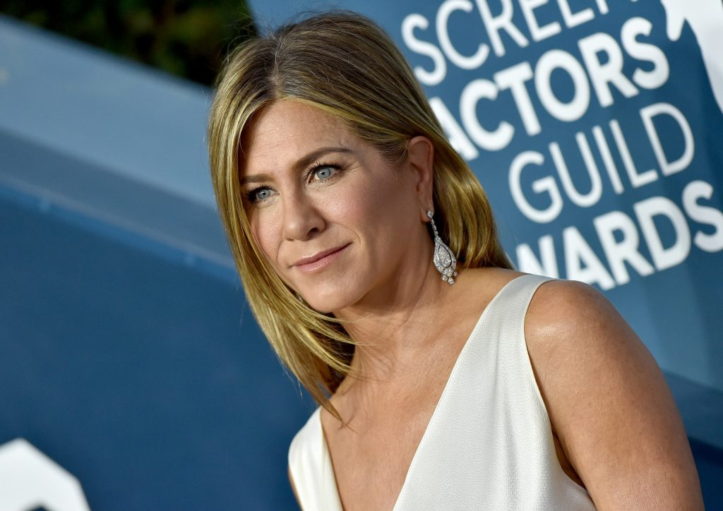 Jennifer Aniston smiling, looking away from the camera