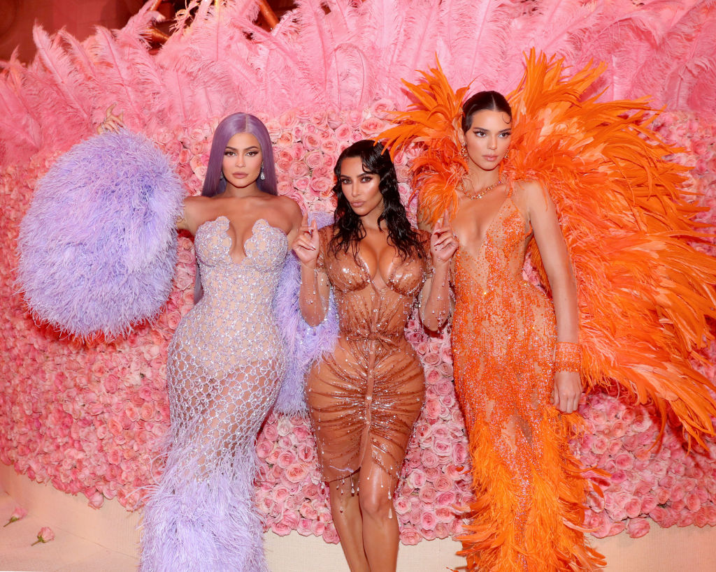 Kylie Jenner, Kim Kardashian West and Kendall Jenner in purple, nude, and orange dresses