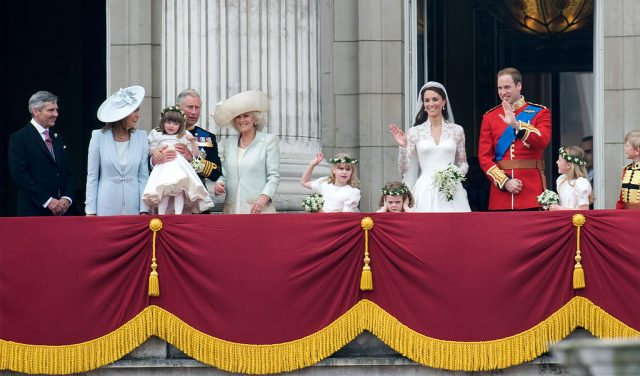 Kate Middleton and Prince William stand on the balcony of Buckingham Palace at their royal wedding with royal family and Middleton family