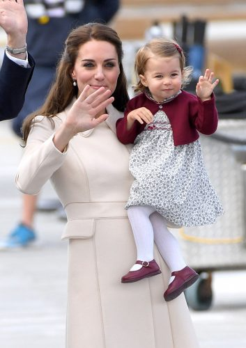 Kate Middleton and Princess Charlotte wave to crowds during a 2016 royal tour of Canada