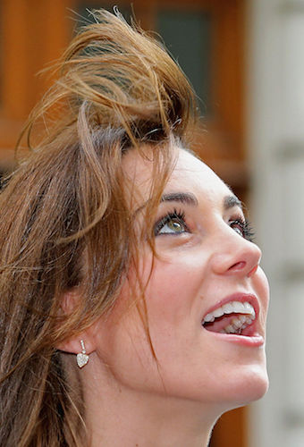 The wind catches the duchess' hair in 2015.