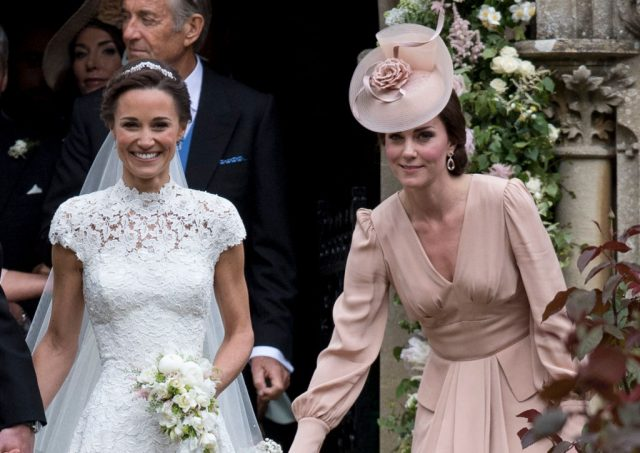 Kate Middleton stands with Pippa Middleton at her wedding