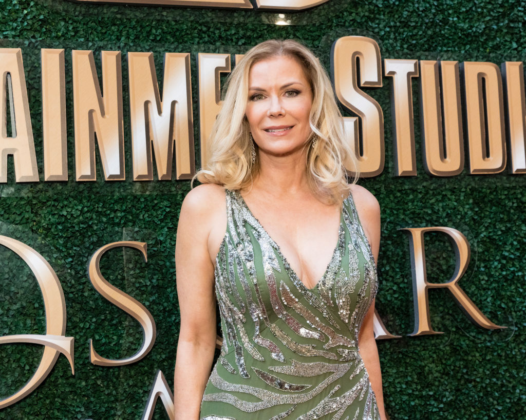 Katherine Kelly Lang smiling in front of a green wall