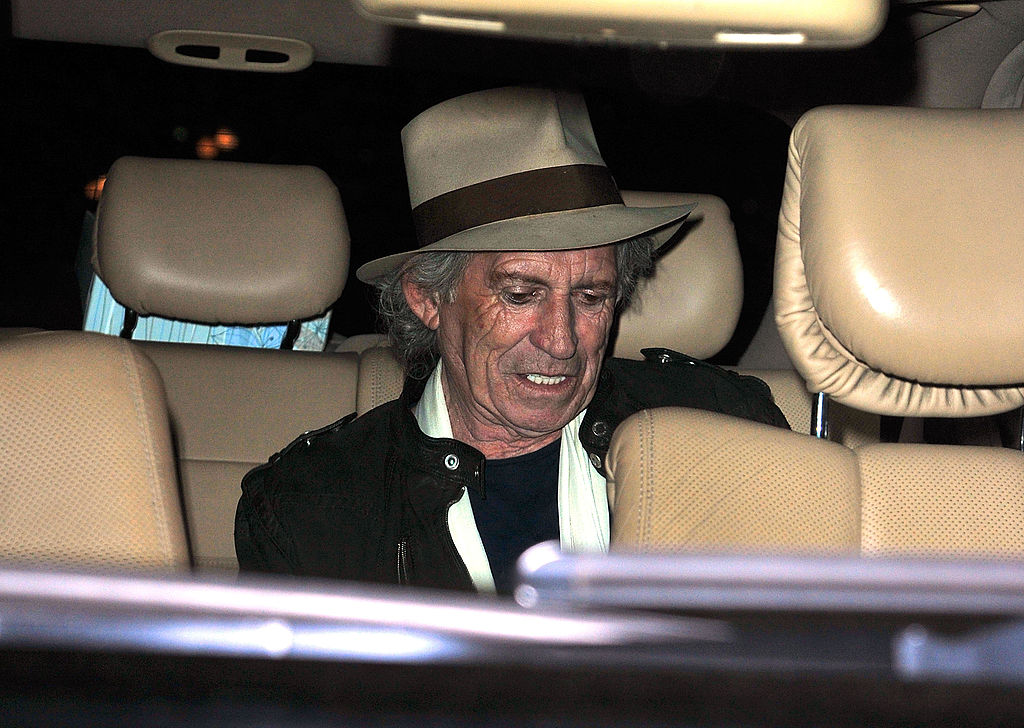 Keith Richards in the back of a car