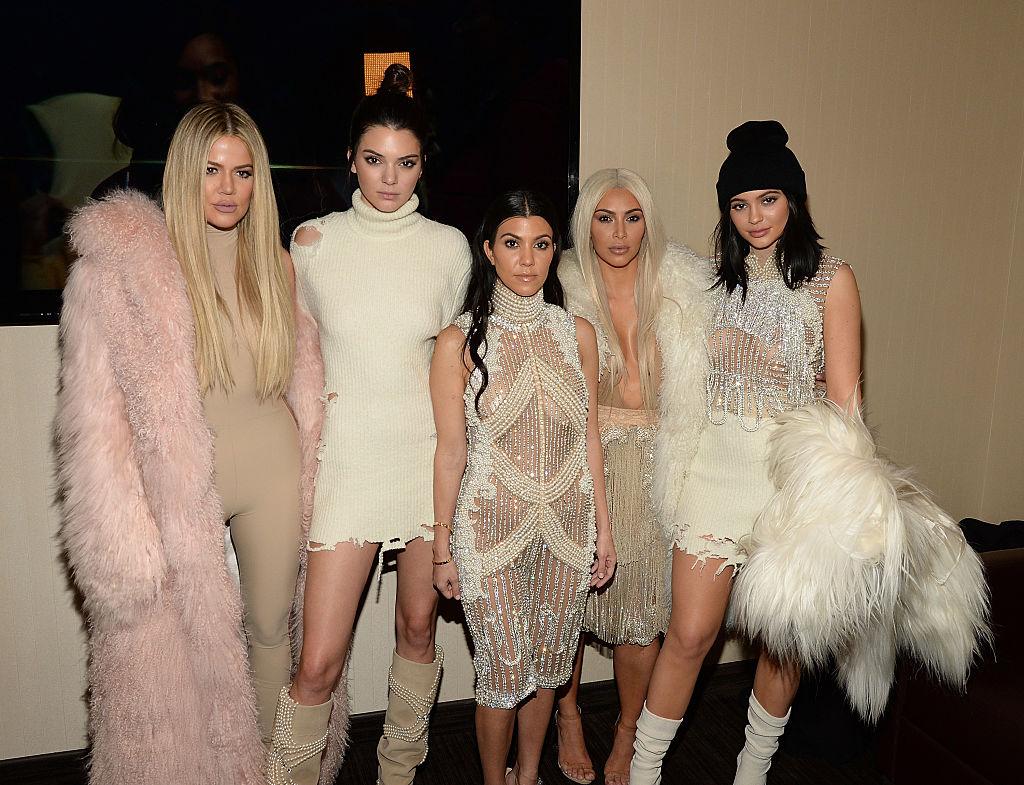 Khloe Kardashian, Kendall Jenner, Kourtney Kardashian, Kim Kardashian West and Kylie Jenner wearing light pink and/or beige