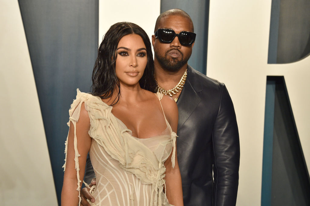 Kim Kardashian West and Kanye West looking off camera