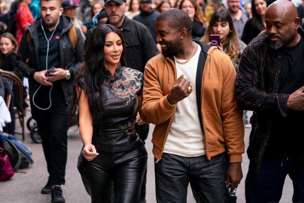 Kim Kardashian West and Kanye West walking down the street