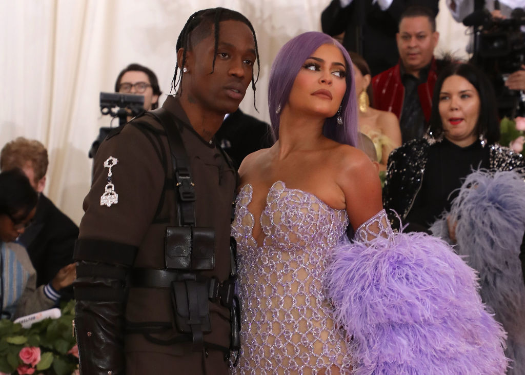 Travis Scott and Kylie Jenner looking away from the camera
