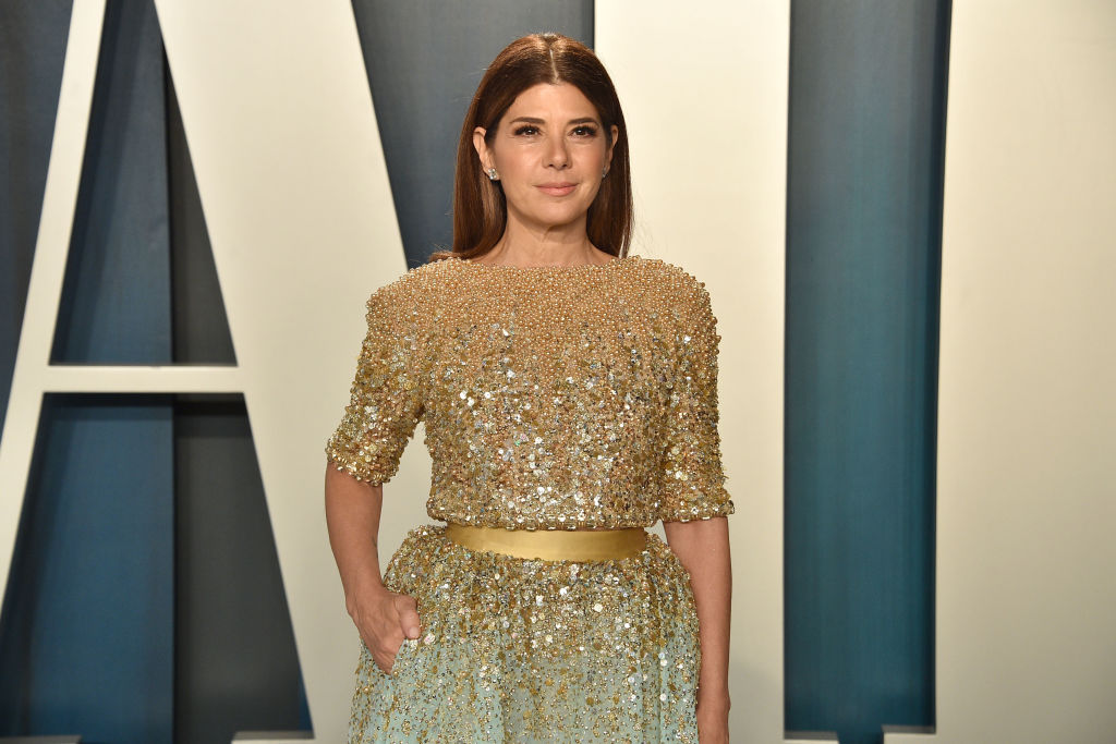 Marisa Tomei smiling in a gold and blue dress