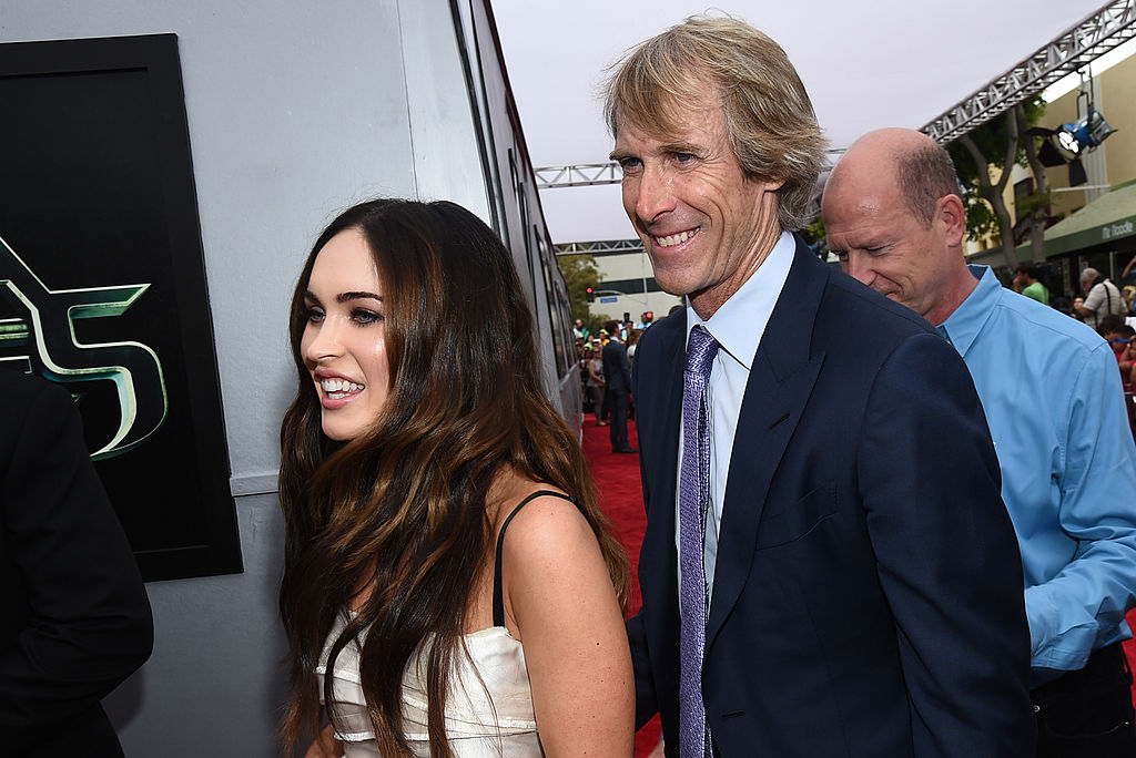Actress Megan Fox (L) and producer Michael Bay attend the premiere of Paramount Pictures' 'Teenage Mutant Ninja Turtles'