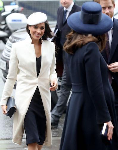 Meghan Markle smiles at Kate Middleton