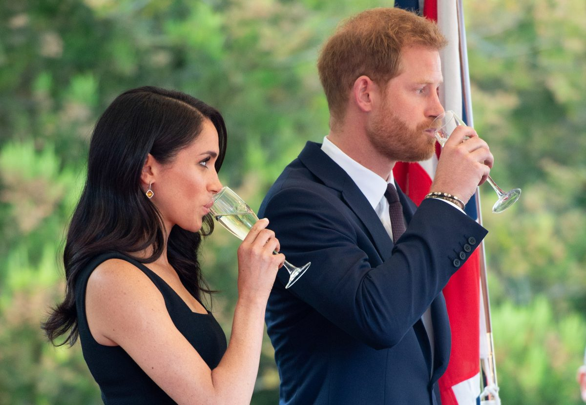 Meghan Markle and Prince Harry toast with champagne while in Ireland