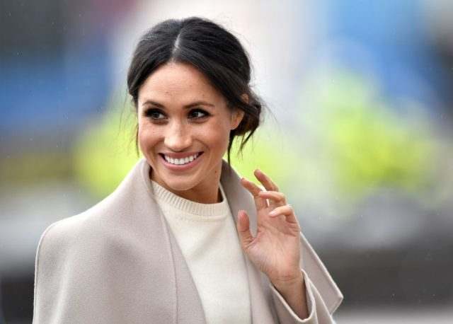 Meghan Markle waves during a visit to Northern Ireland in 2018