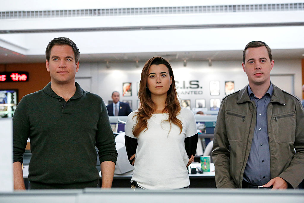 Michael Weatherly, Cote de Pablo, and Sean Murray on the set of NCIS | Cliff Lipson/CBS via Getty Images