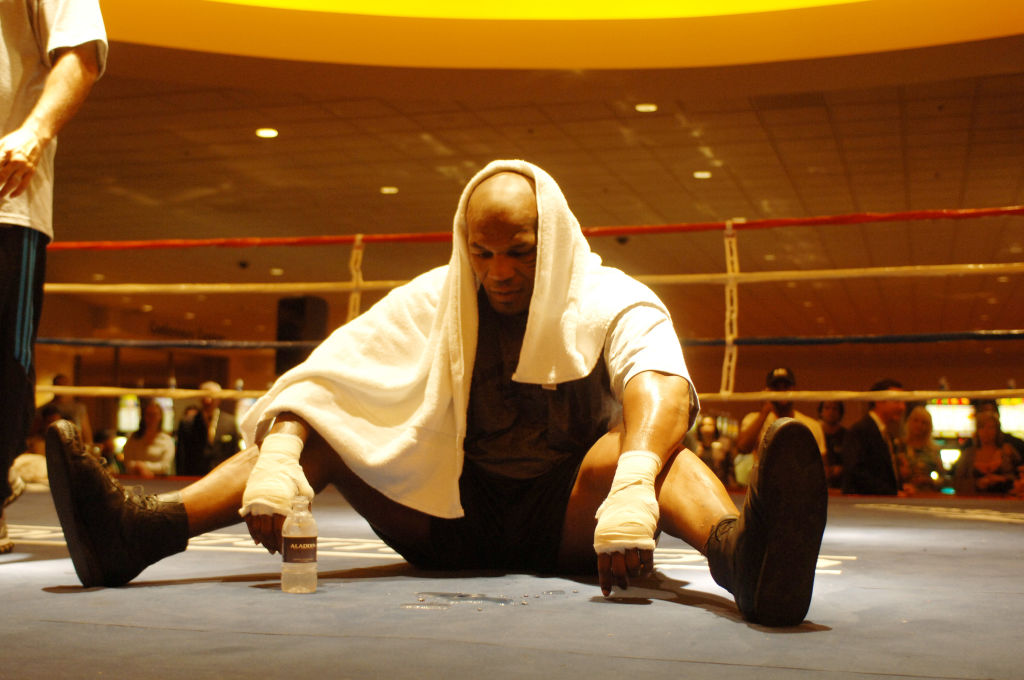 Mike Tyson sitting down during a training camp