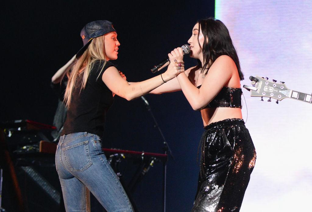 Miley Cyrus and Noah Cyrus performing