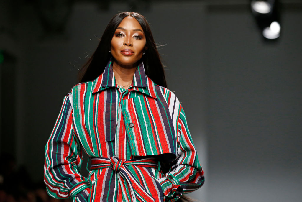 Naomi Campbell on a runway, smiling