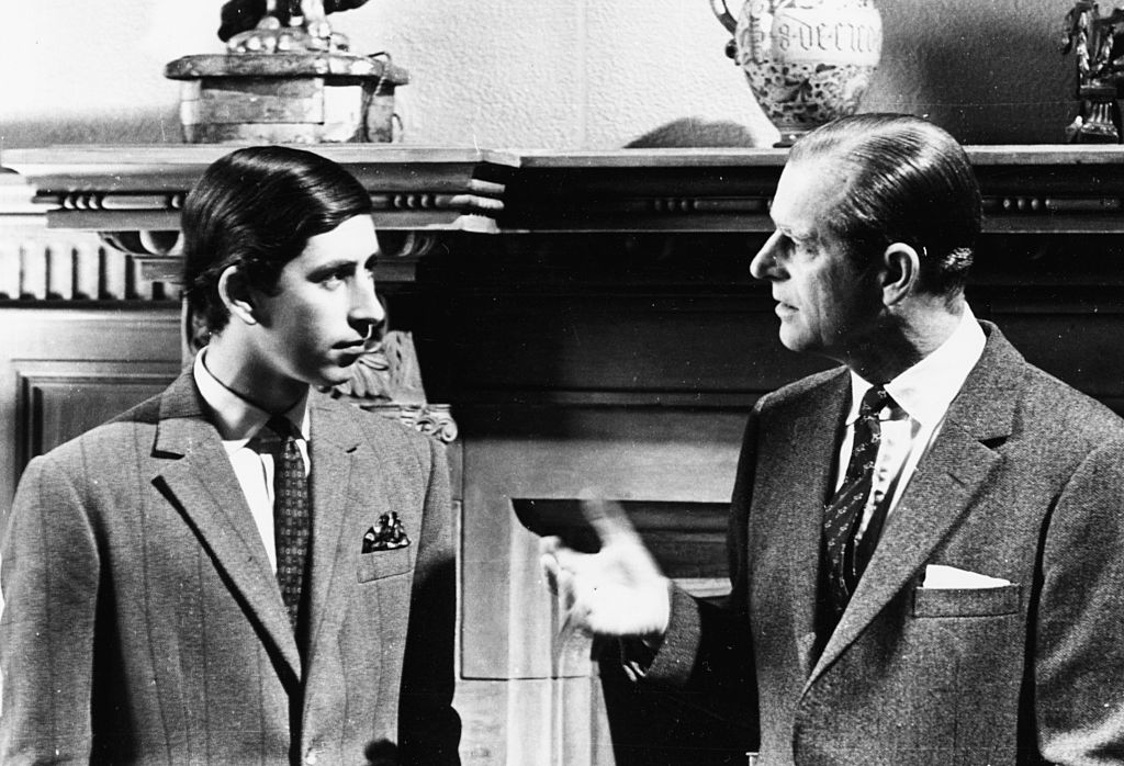 Prince Charles (left) talking to his father, the Duke of Edinburgh, in front of a fireplace at Sandringham, Scotland, 1969.