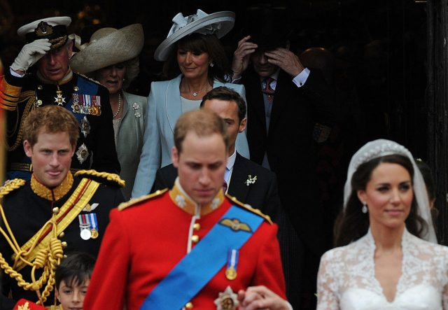Prince William and Kate Middleton at their royal wedding followed by family