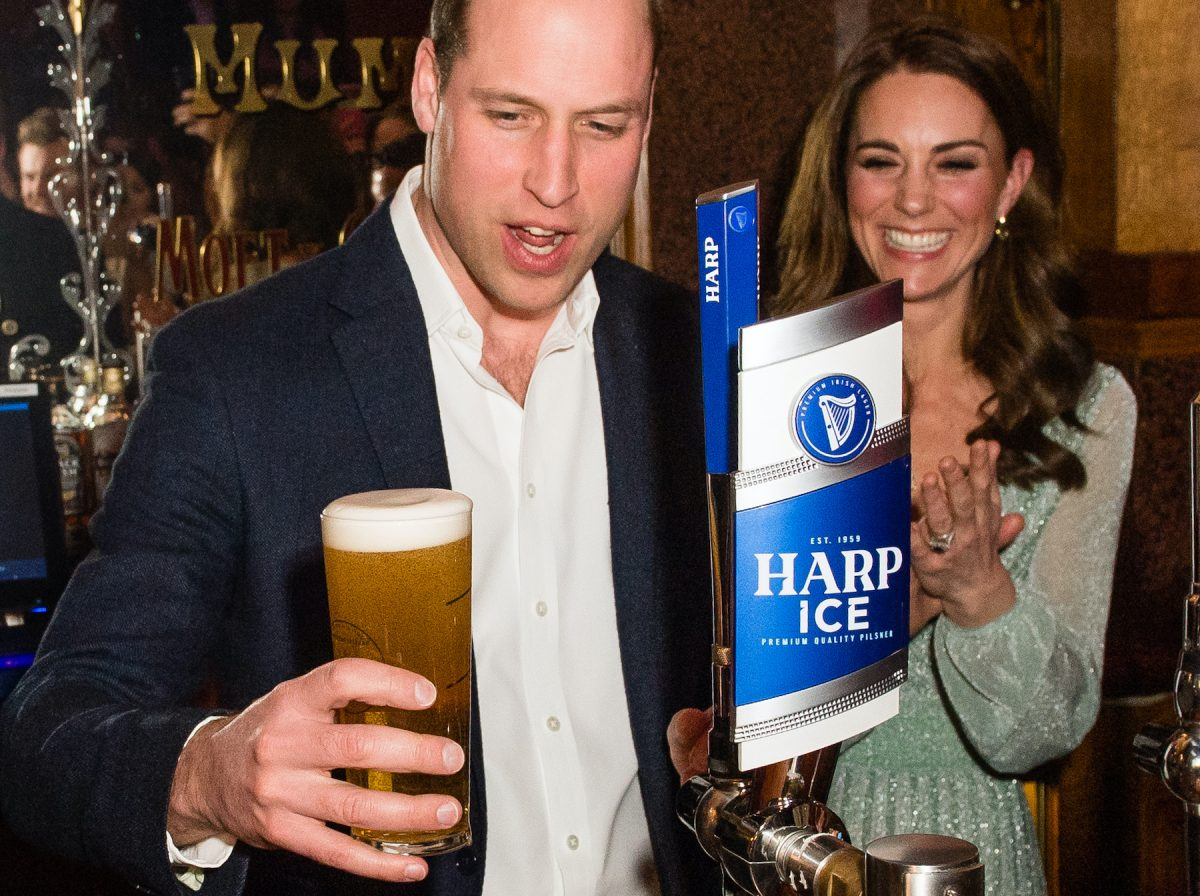 Prince William pours a pint of beer while Kate Middleton watches
